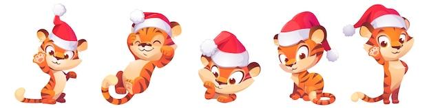Caractère Mignon De Bébé Tigre Dans Le Chapeau De Noël Vecteur gratuit
