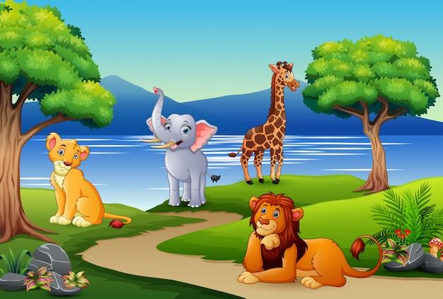 Caricature d'animaux heureux sur la scène de la nature