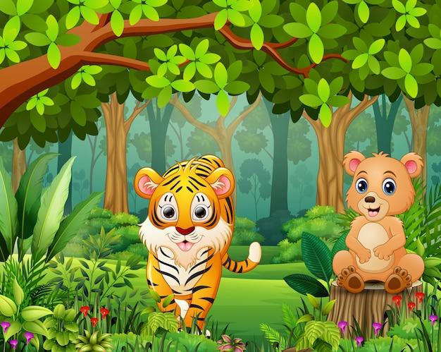Caricature d'animaux sauvages heureux dans une belle forêt verte