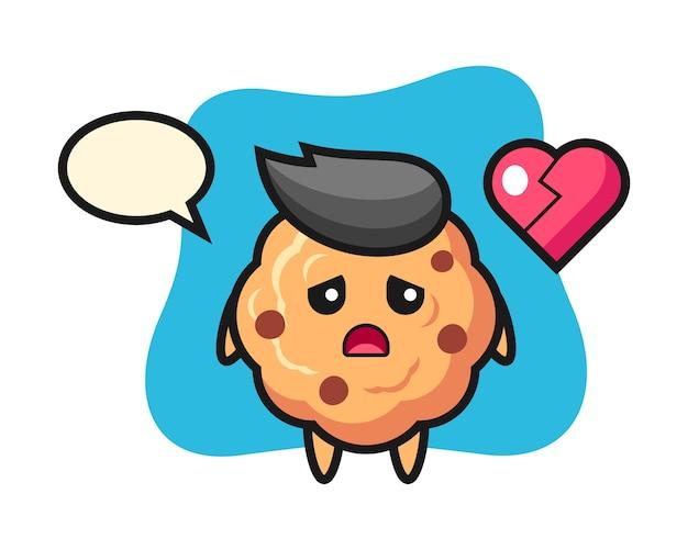 Caricature de cookie aux pépites de chocolat est coeur brisé