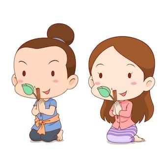 Caricature de couple mignon en costume thaïlandais priant avec bâtons d'encens et lotus.