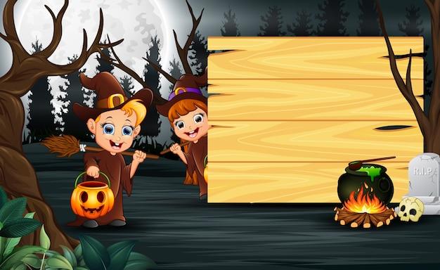 Caricature de couple de sorcière debout à côté d'une planche de bois