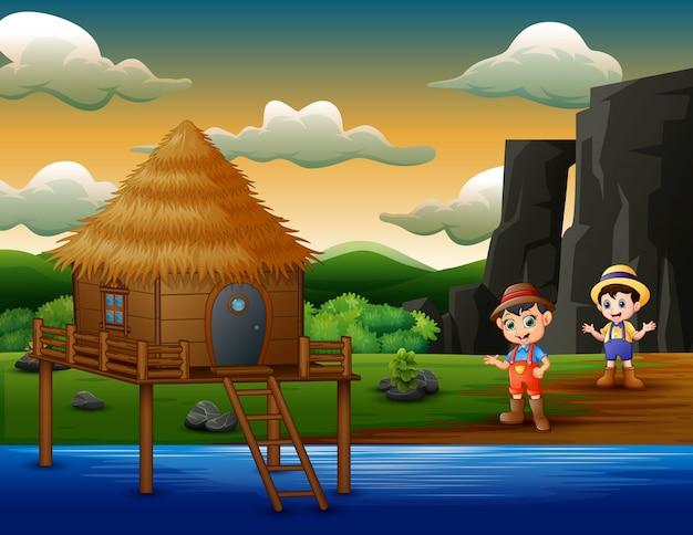 Caricature de deux garçons d'agriculteurs au bord de la rivière