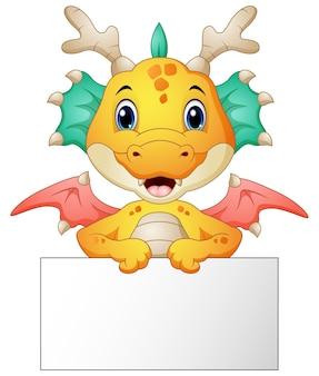 Caricature de drôle de dragon tenant une pancarte blanche