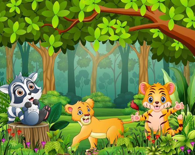 Caricature du paysage forestier avec différents animaux
