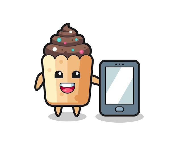 Caricature d'illustration de cupcake tenant un smartphone, design mignon