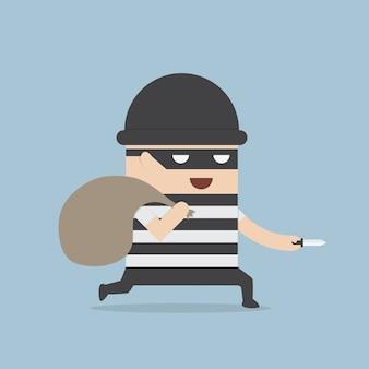 Caricature de voleur tenant le couteau dans sa main et portant un sac d'argent