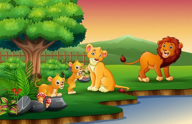 Les caricatures de la famille lion profitent de la nature au bord de la rivière