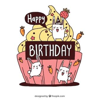 Carte d'anniversaire avec un délicieux petit gâteau et agréable lapins dessinés à la main