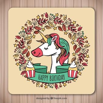 Carte d'anniversaire dessiné à la main avec la licorne et les feuilles
