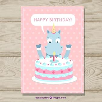 Carte d'anniversaire avec une licorne et un gâteau