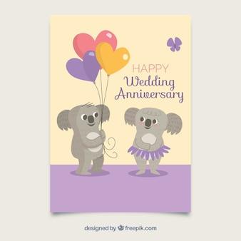 Carte d'anniversaire de mariage avec un couple mignon koalas