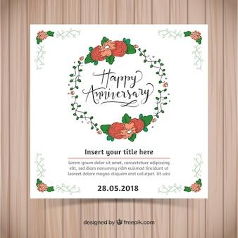 Carte d'anniversaire de mariage avec une couronne florale