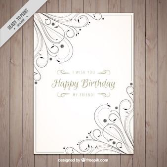 Carte d'anniversaire avec ornamets floraux