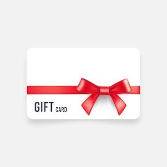 Carte-cadeau avec noeud rouge et ruban