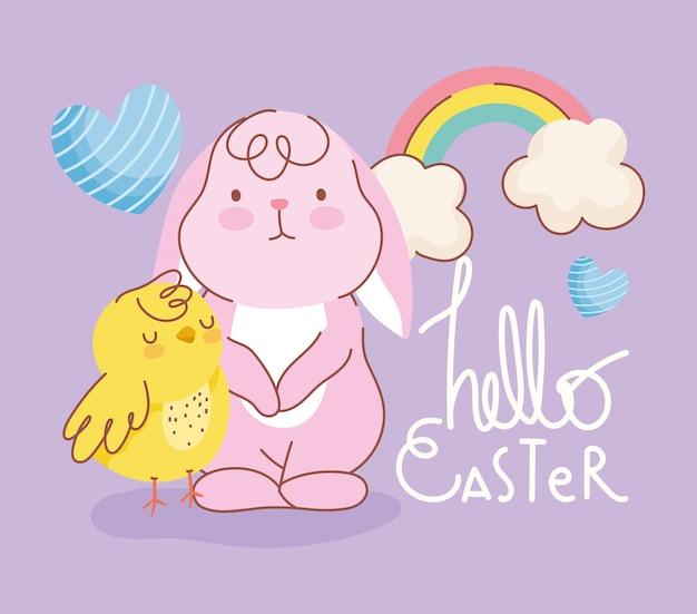 Carte de célébration de coeurs arc-en-ciel de poulet lapin de pâques heureux