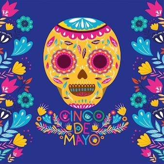 Carte de cinco de mayo avec des fleurs et un masque de crâne