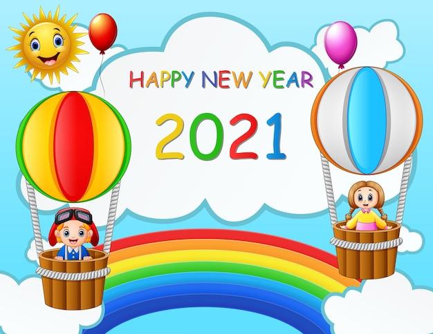 Carte de conception de nouvel an avec des enfants dans des ballons à air