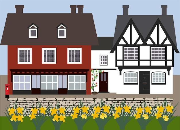 Carte avec des cottages anglais et des jonquilles.