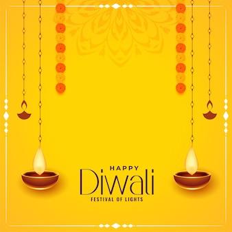 Carte décorative jaune joyeux diwali avec motif diya suspendu