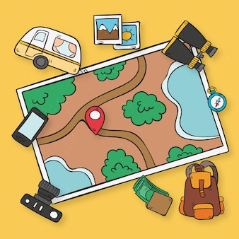 Carte dessinée avec des éléments de voyage à la main