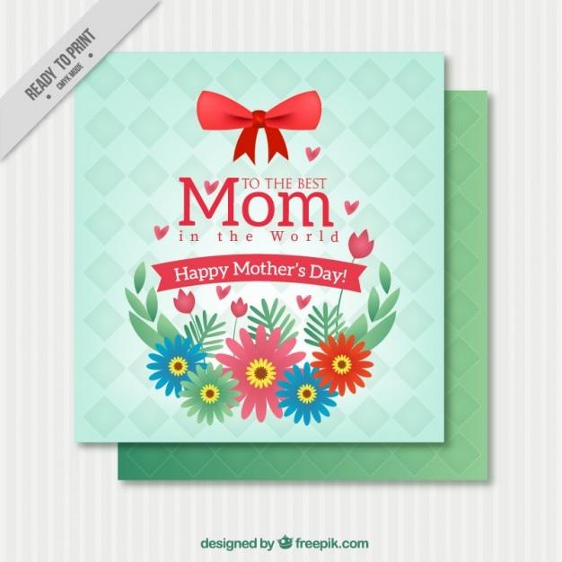 Carte du jour de mère heureux avec des fleurs et un arc rouge