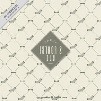 Carte du jour de père avec nœud papillon et de la chaussette