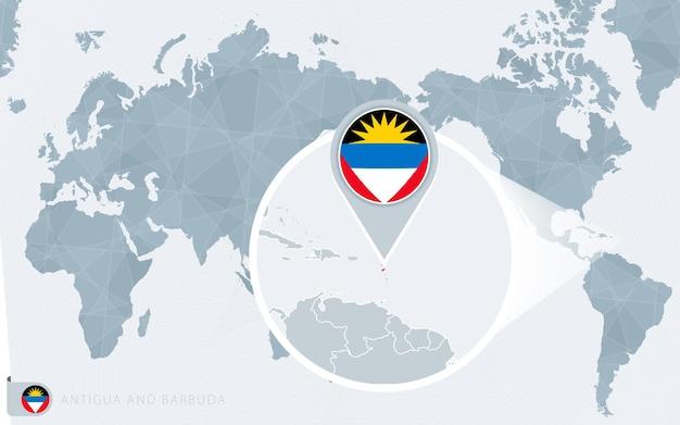 Carte du monde centrée sur le pacifique avec antigua-et-barbuda agrandie. drapeau et carte d'antigua-et-barbuda.