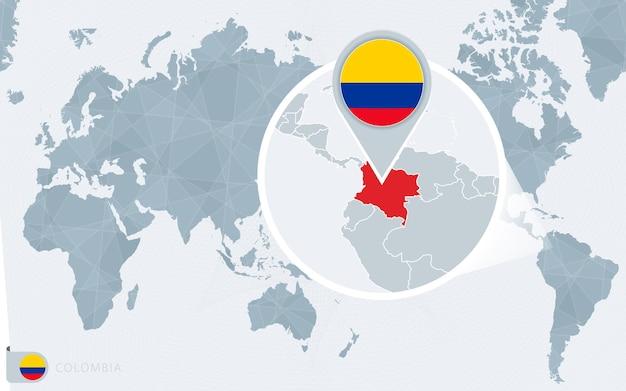 Carte du monde centrée sur le pacifique avec la colombie agrandie. drapeau et carte de la colombie.
