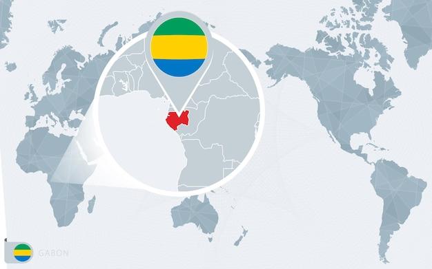 Carte du monde centrée sur le pacifique avec le gabon agrandi. drapeau et carte du gabon.