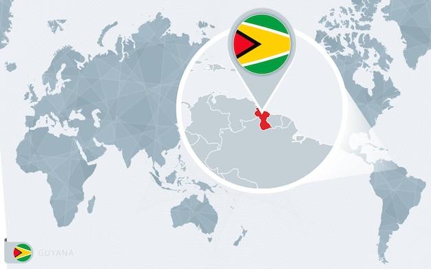 Carte du monde centrée sur le pacifique avec la guyane agrandie. drapeau et carte de la guyane.
