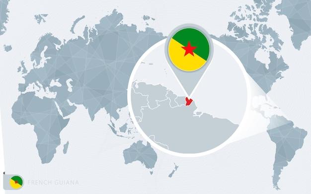 Carte du monde centrée sur le pacifique avec la guyane française agrandie. drapeau et carte de la guyane française.