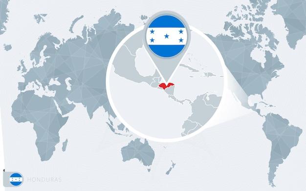 Carte du monde centrée sur le pacifique avec le honduras agrandi. drapeau et carte du honduras.