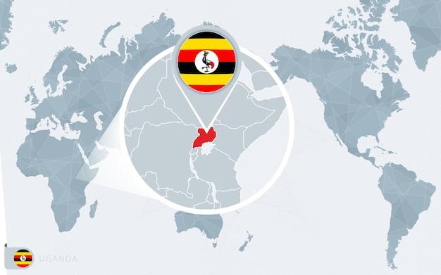 Carte du monde centrée sur le pacifique avec l'ouganda agrandie. drapeau et carte de l'ouganda.