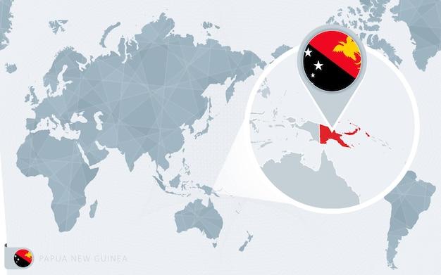 Carte du monde centrée sur le pacifique avec la papouasie-nouvelle-guinée agrandie. drapeau et carte de la papouasie-nouvelle-guinée.