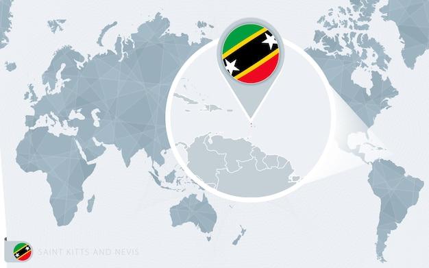 Carte du monde centrée sur le pacifique avec saint-kitts-et-nevis agrandie. drapeau et carte de saint kitts et nevis.
