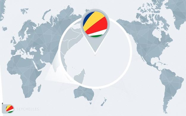 Carte du monde centrée sur le pacifique avec les seychelles agrandies. drapeau et carte des seychelles.