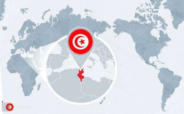 Carte du monde centrée sur le pacifique avec la tunisie agrandie. drapeau et carte de la tunisie.