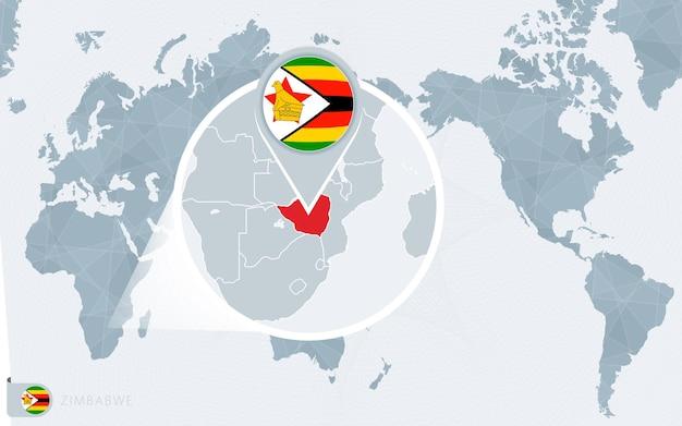 Carte du monde centrée sur le pacifique avec le zimbabwe agrandi. drapeau et carte du zimbabwe.