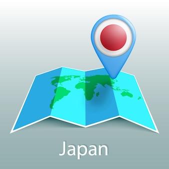 Carte du monde du drapeau du japon en broche avec le nom du pays sur fond gris