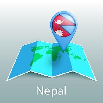 Carte du monde du drapeau du népal en broche avec le nom du pays sur fond gris