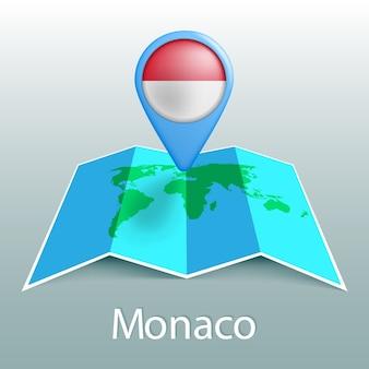 Carte du monde du drapeau de monaco en broche avec le nom du pays sur fond gris