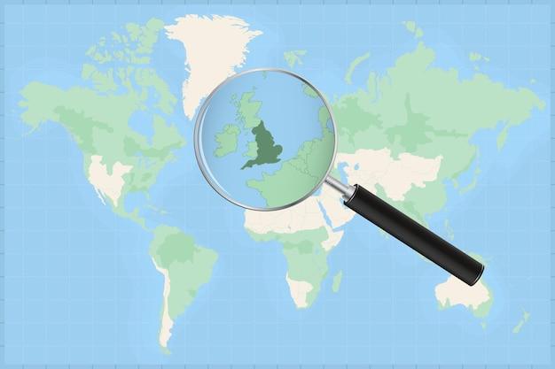 Carte du monde avec une loupe sur une carte de l'angleterre