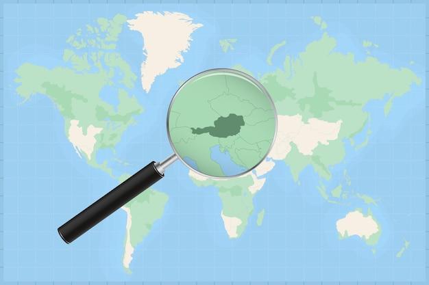 Carte du monde avec une loupe sur une carte de l'autriche.