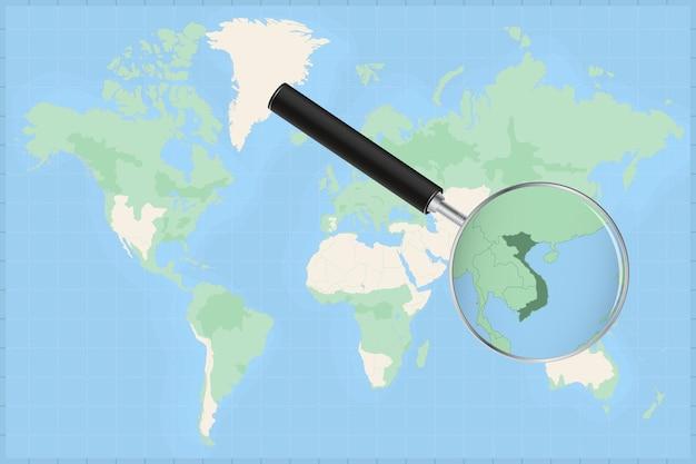 Carte du monde avec une loupe sur une carte du vietnam.