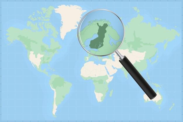 Carte du monde avec une loupe sur une carte de la finlande.