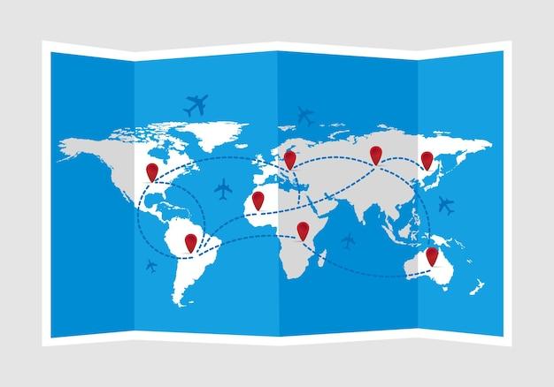 Carte du monde pliée avec des avions et des marqueurs voyage et tourisme