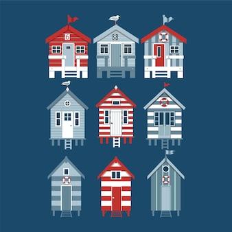 Carte avec ensemble de cabines de plage avec des drapeaux de mouettes