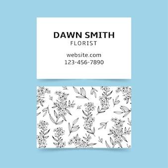 Carte d'entreprise dessinée à la main réaliste avec des fleurs