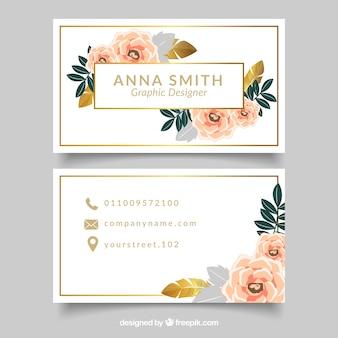 Carte d'entreprise élégante avec des fleurs et des détails dorés